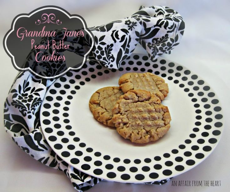 Grandma Jane's Peanut Butter Cookies on a white plate with black polka dots