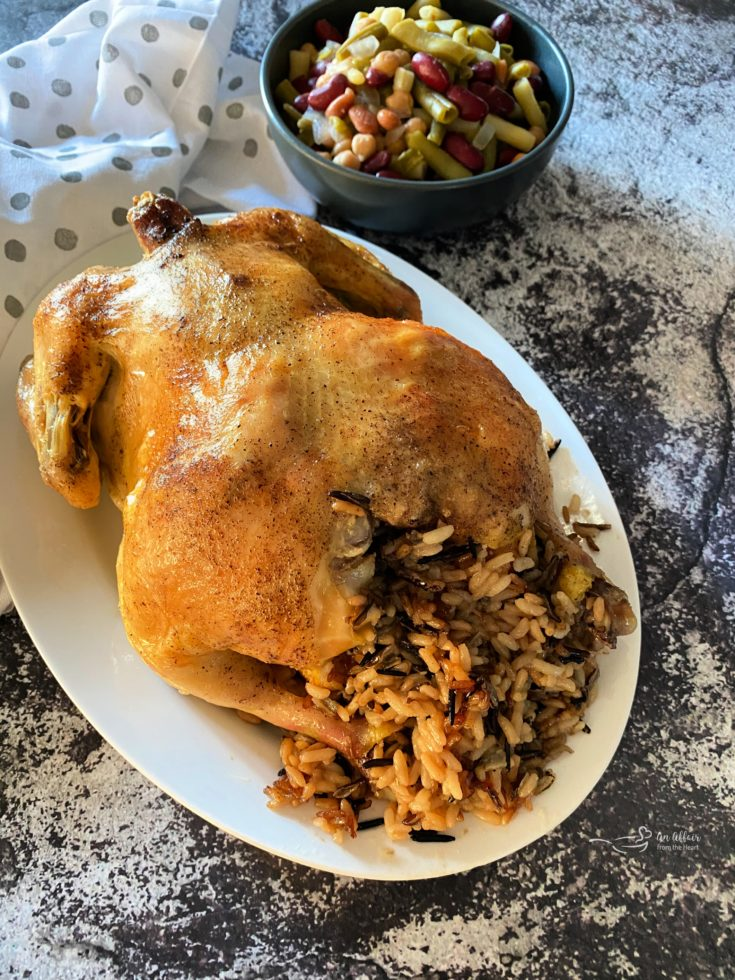 Baked Chicken & Wild Rice on a white serving platter