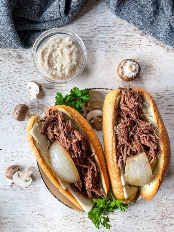 two french onion french dip sandwiches