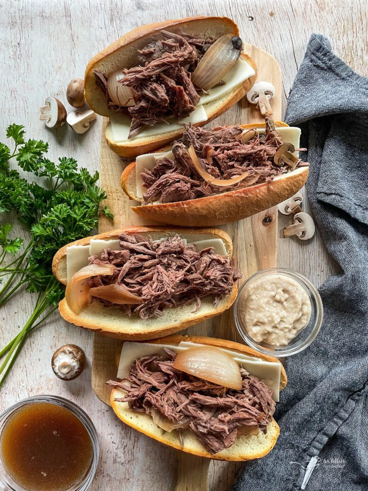 top view of four french dip sandwiches