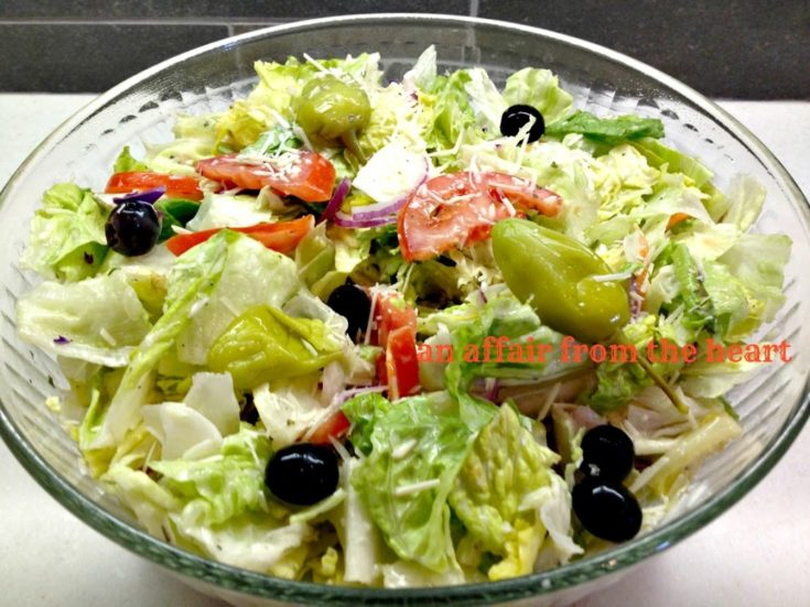Copy cat Olive Garden Salad in a clear serving bowl