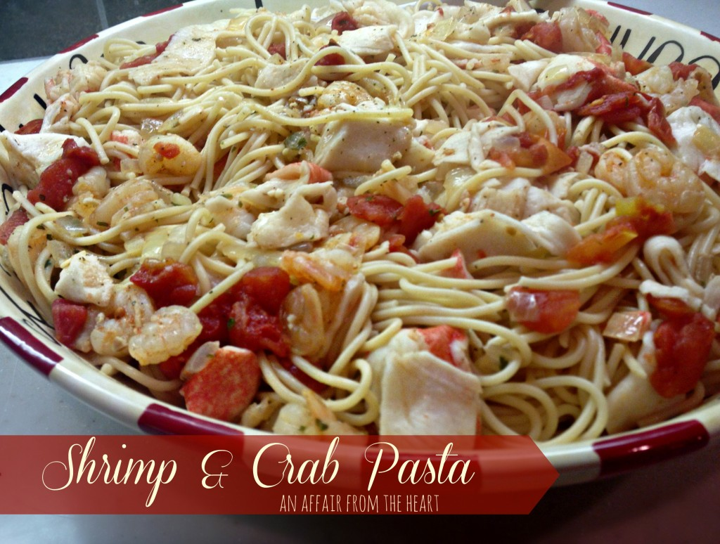 shrimp and crab pasta in a bowl