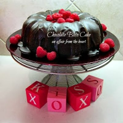 Chocolate Bliss Cake with Raspberry Sauce and Devonshire Cream