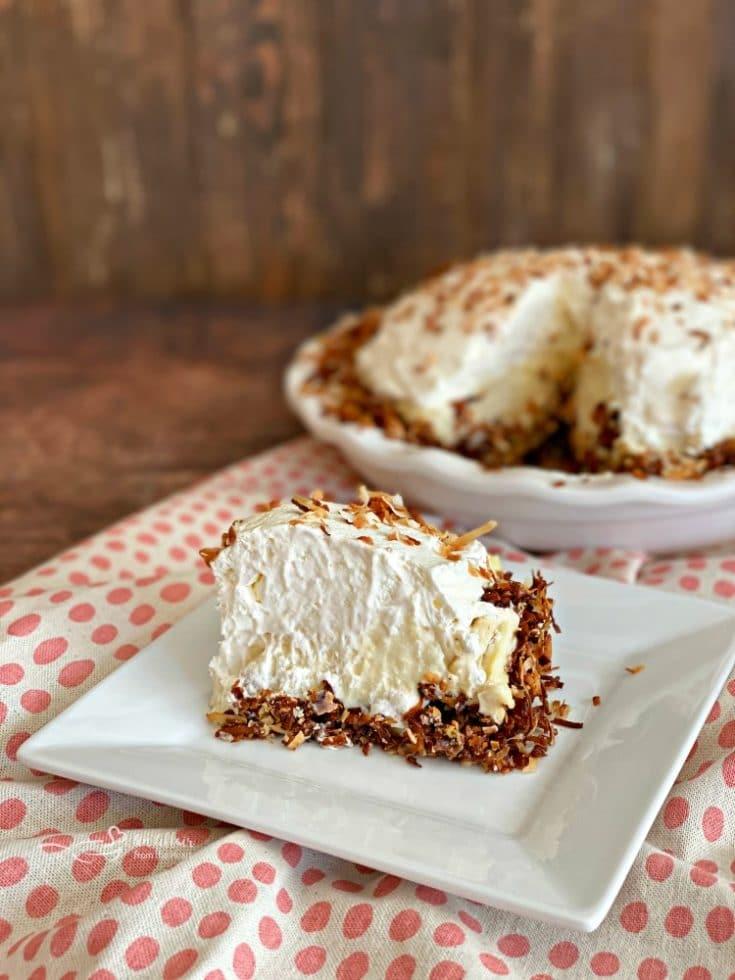 sliced Coconut Banana Cream Pie on a white plate