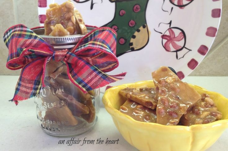 Close up of Peanut brittle in a yellow bowl and a gift jar