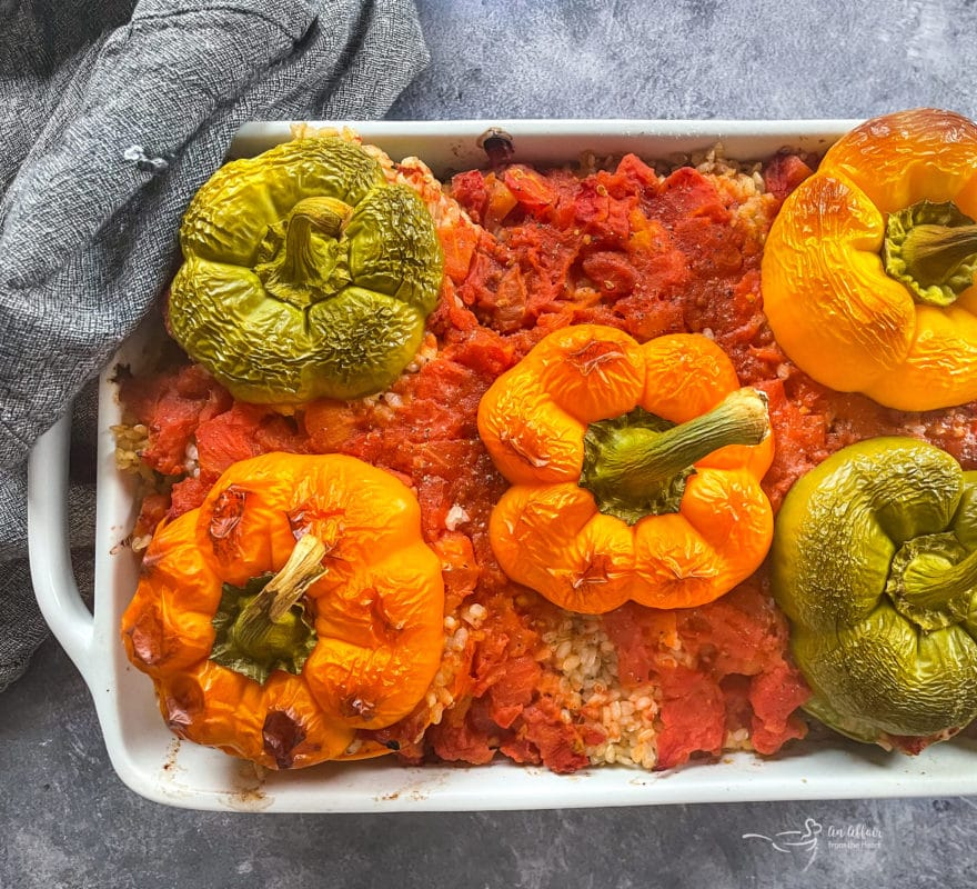 One pan filled with rice and stuffed peppers