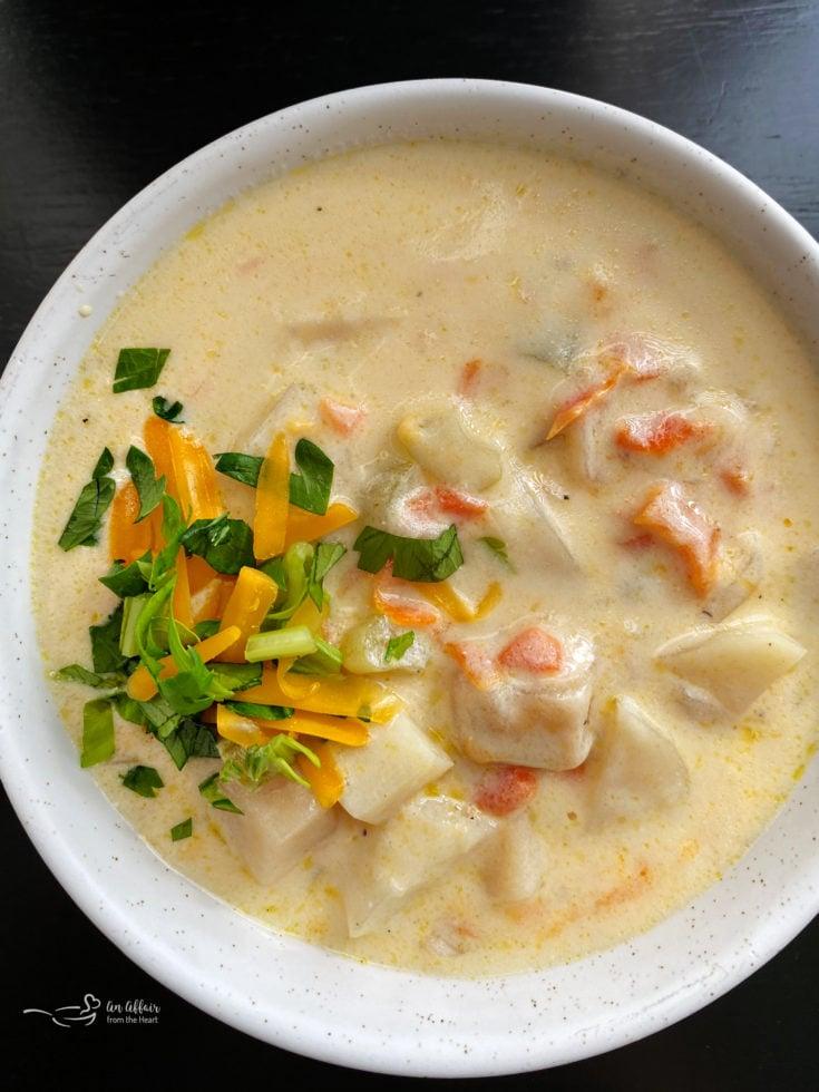 Top view of potato soup in white bowl
