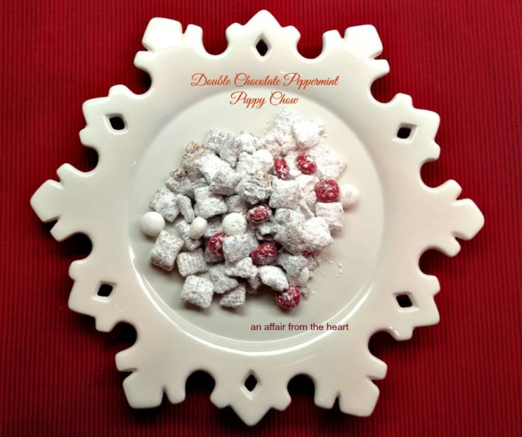 double chocolate peppermint puppy chow on a white snowflake serving platter