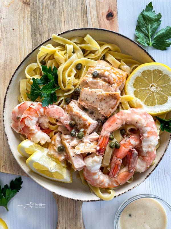 top view of lemon caper sauce with salmon and shrimp