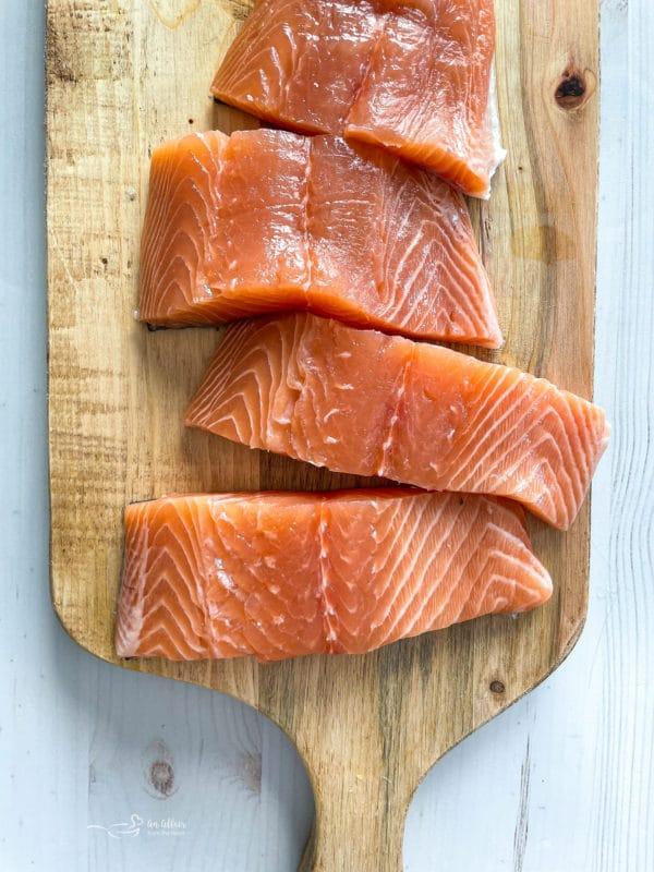 top view of salmon on cutting board