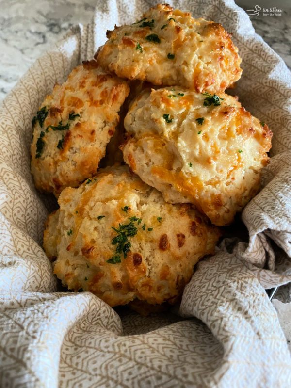 Top view of Cheddar Bay biscuits in basket with linen