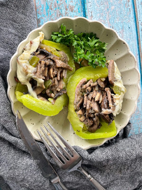 serving dish of philly cheesesteak stuffed peppers
