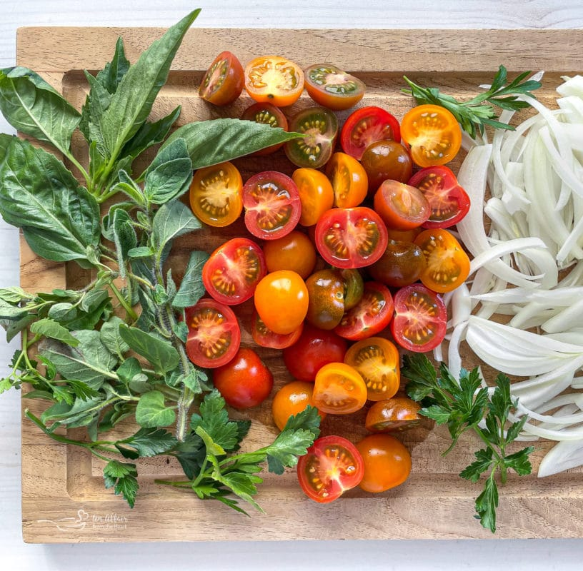 basil, tomatoes, and onions on wooden cutting board