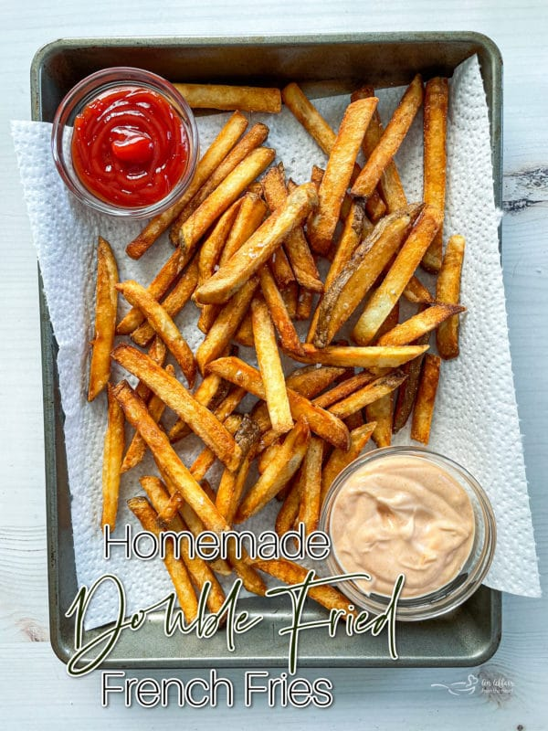 Top view of fries on baking sheet with ketchup