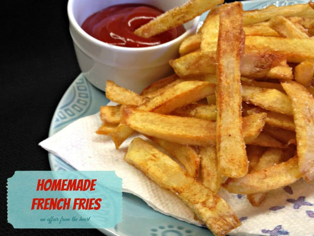 "close up of french fries and a small bowl of ketchup on a plate with text ""homemade french fries"""
