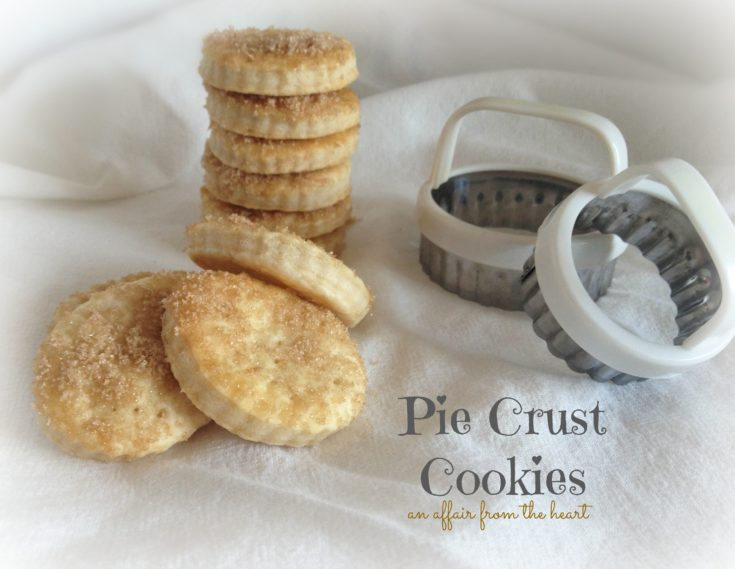 pie crust cookies and cookie cutters on a white cloth
