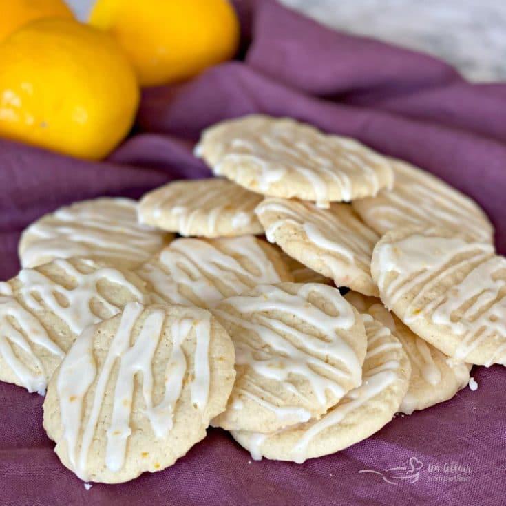 Chewy glazed lemon cookies on a purple cloth