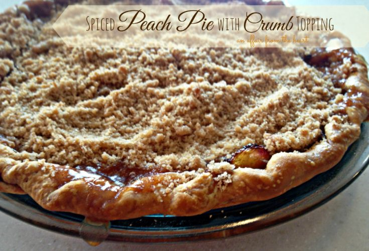 Close up of spiced peach pie with crumb topping