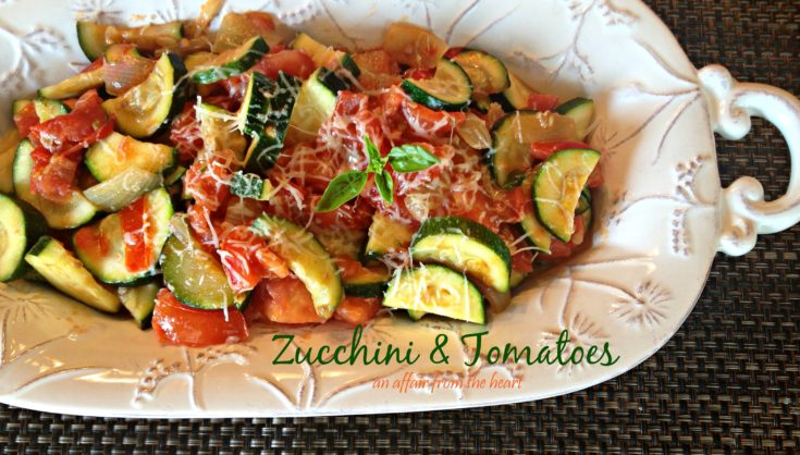 zucchini & tomatoes on a white serving platter