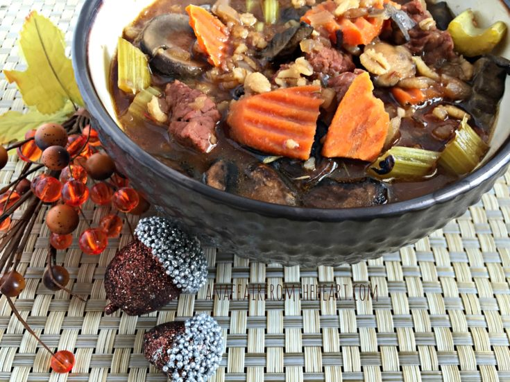 Vegetable Beef, Barley & Mushroom Soup in a black bowl
