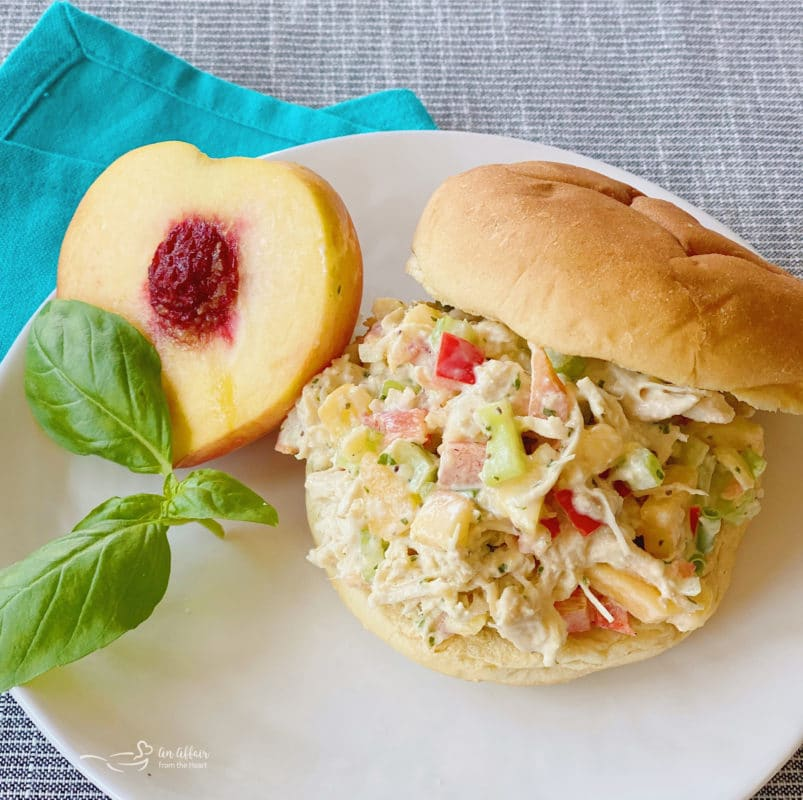 sandwich on white plate with peach