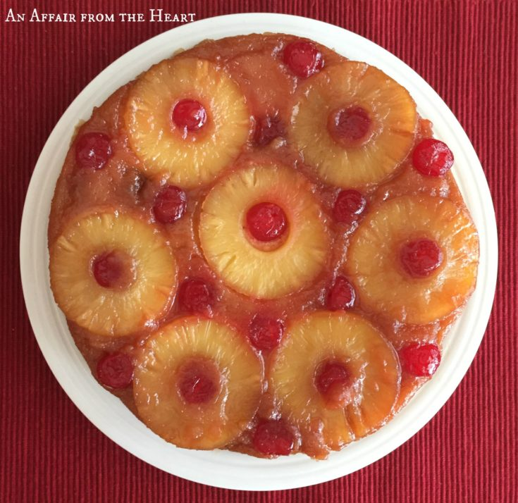 Overhead of From Scratch Pineapple Upside Down Cake on a whit plate