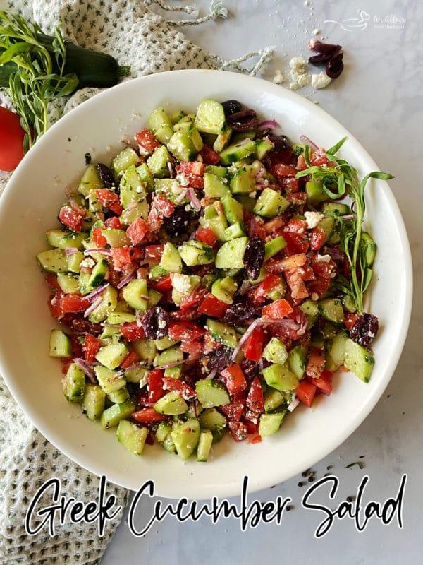 Greek cucumber salad in white bowl
