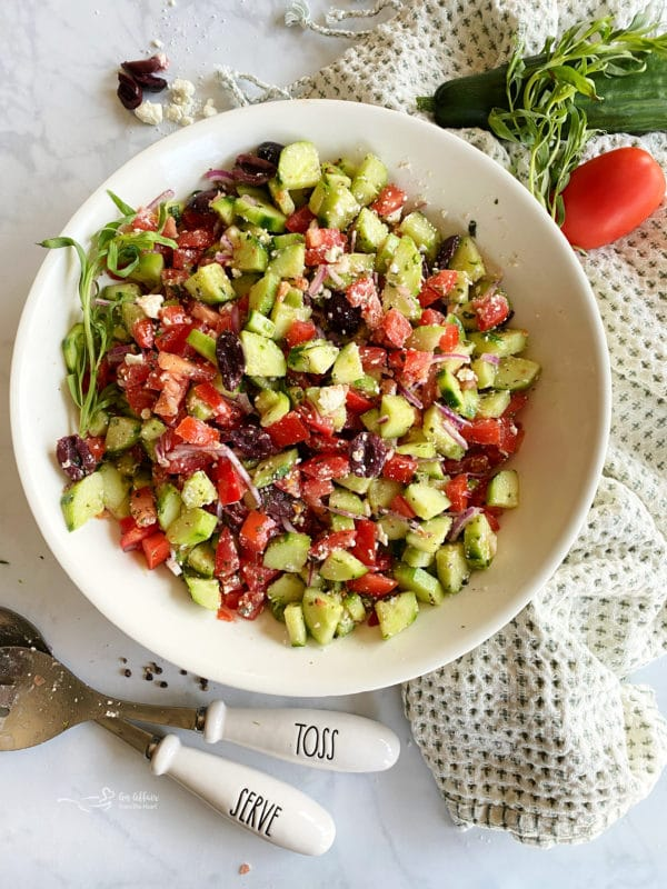 White bowl filled with Greek style cucumber salad