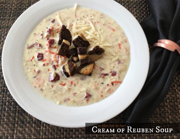 Cream of Reuben Soup in a white bowl