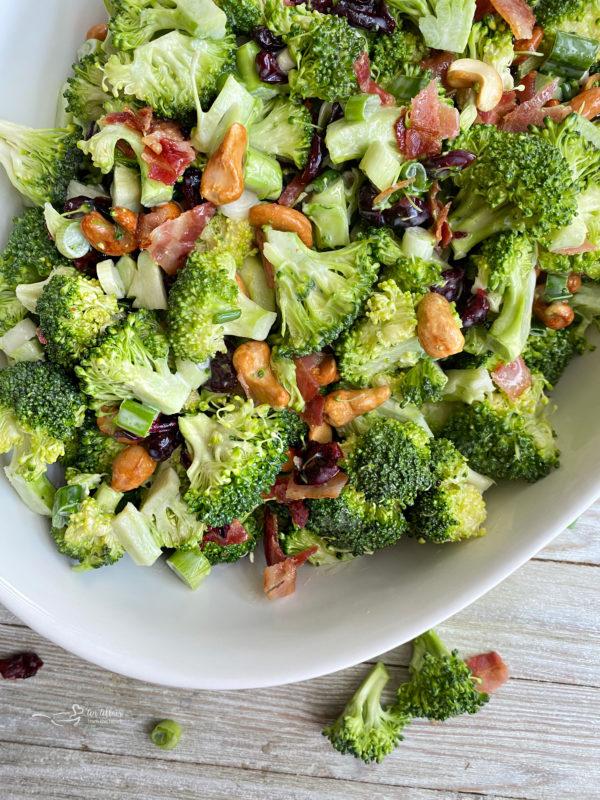 Top view of white bowl filled with bacon cashew broccoli salad