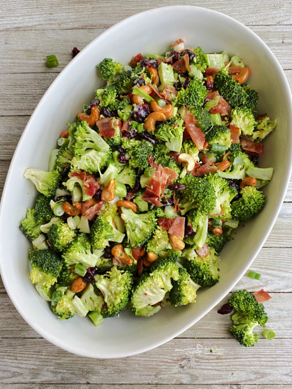 One bowl filled with bacon cashew broccoli salad