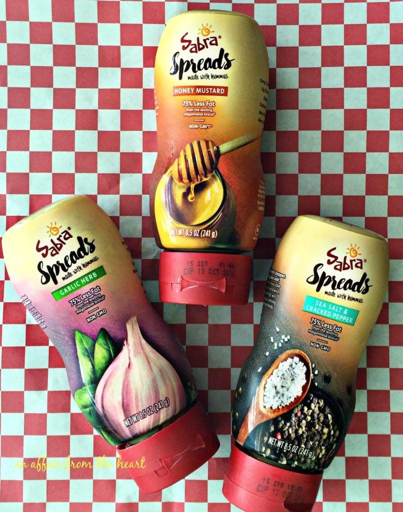 Garlic Herb, Honey Mustard and Sea Salt & Cracked Pepper Sabra Spreads™ with Hummus