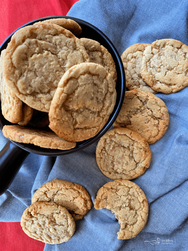 overhead of butter brickle cookies in a bowl and on a table