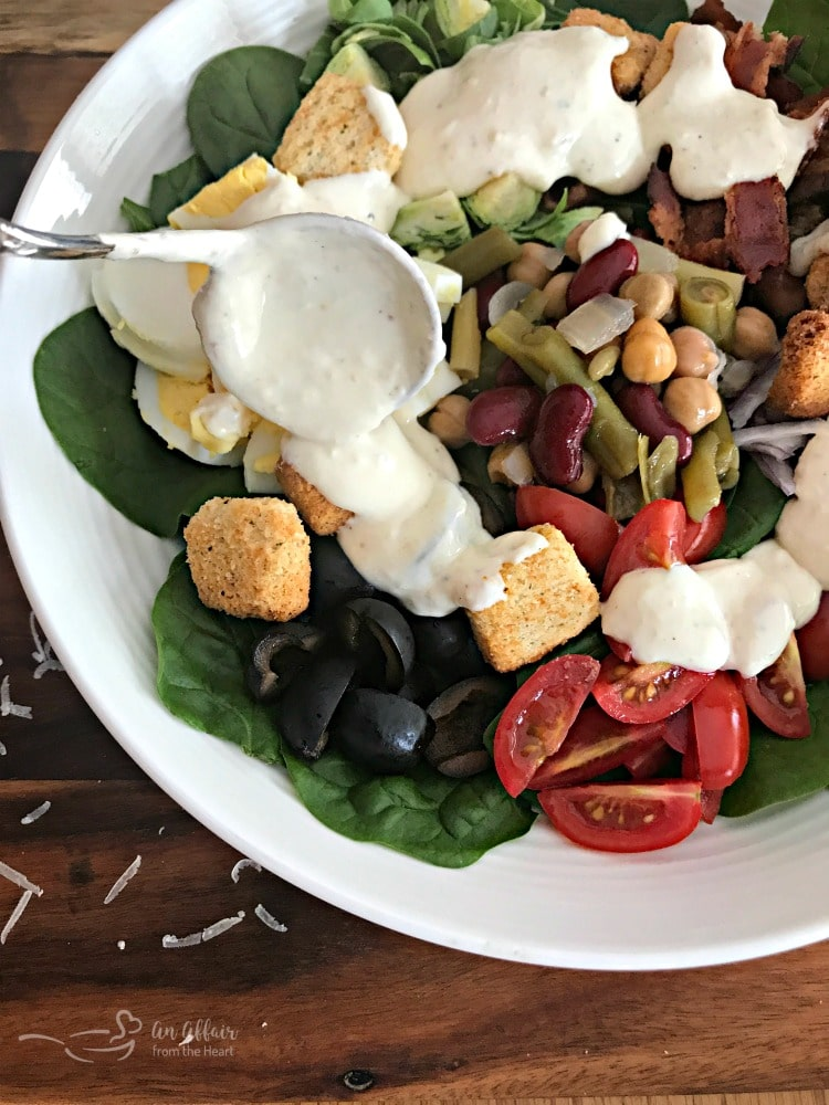 Loaded Spinach Salad with Creamy Roasted Garlic Dressing