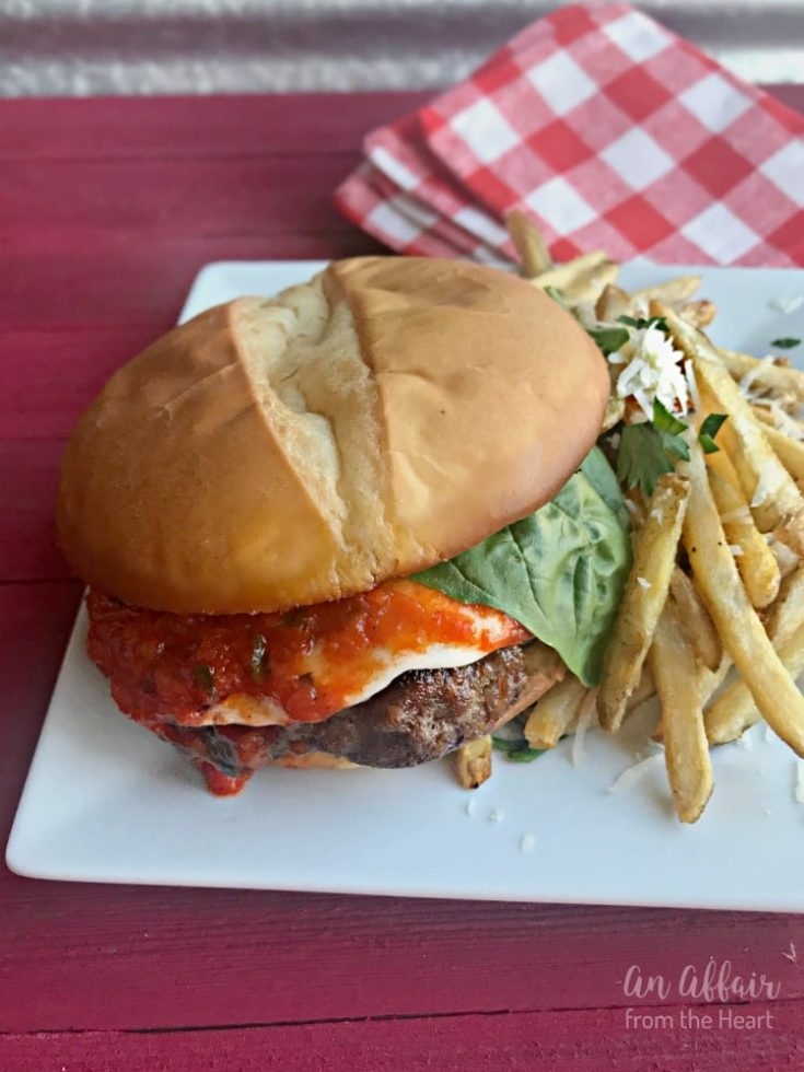 Italian Burger and french fries on a white plate