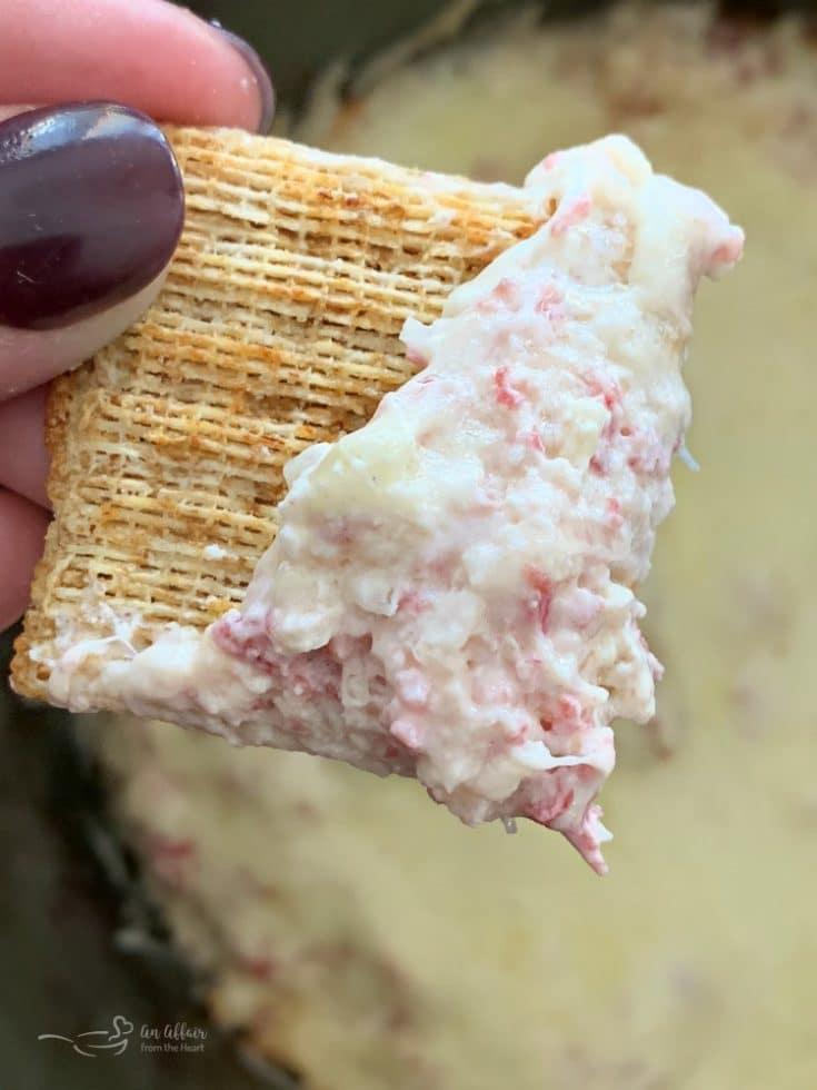 Crock Pot Reuben Dip close up on a cracker