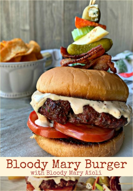 Bloody Mary Burger with garnish on grey platter pinnable image