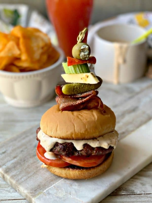Bloody Mary Burger with garnish on grey platter