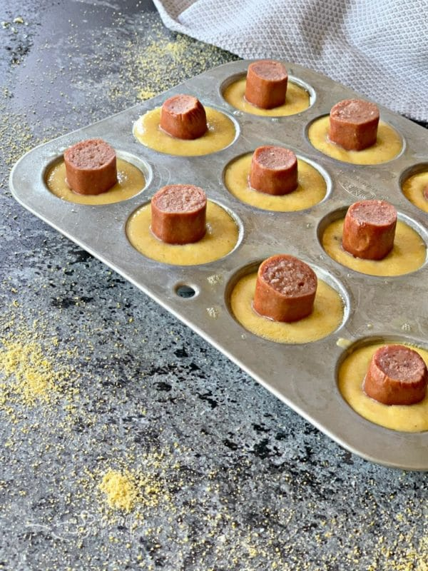 Corn Dog Mini Muffins prep with hot dogs