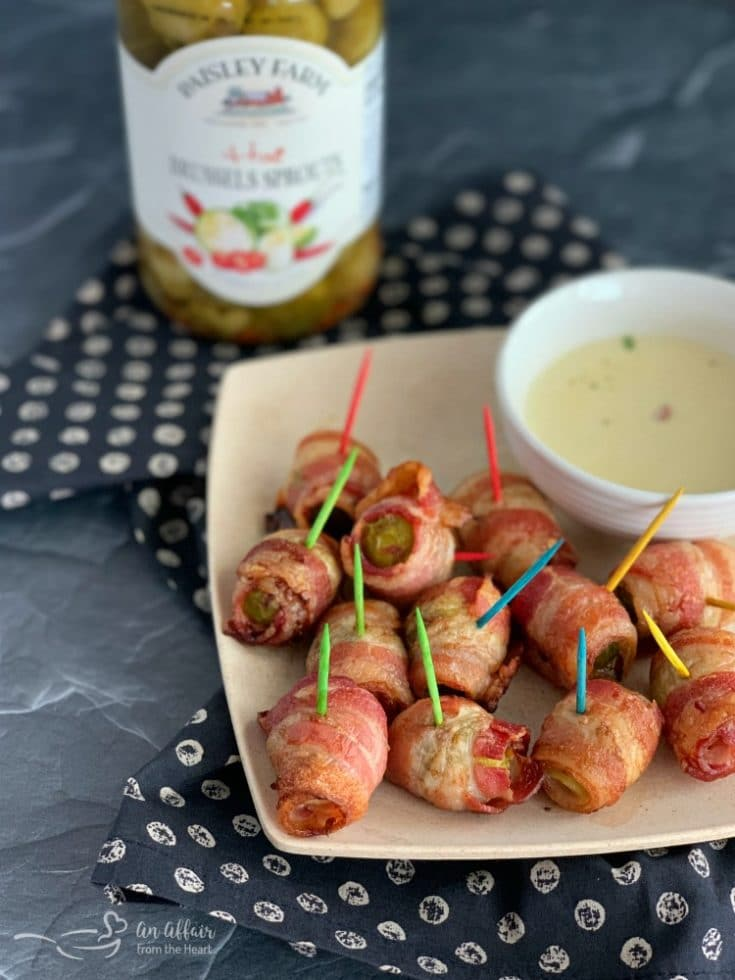 Bacon Wrapped Hot Brussels Sprouts Paisley farm with cheese sauce