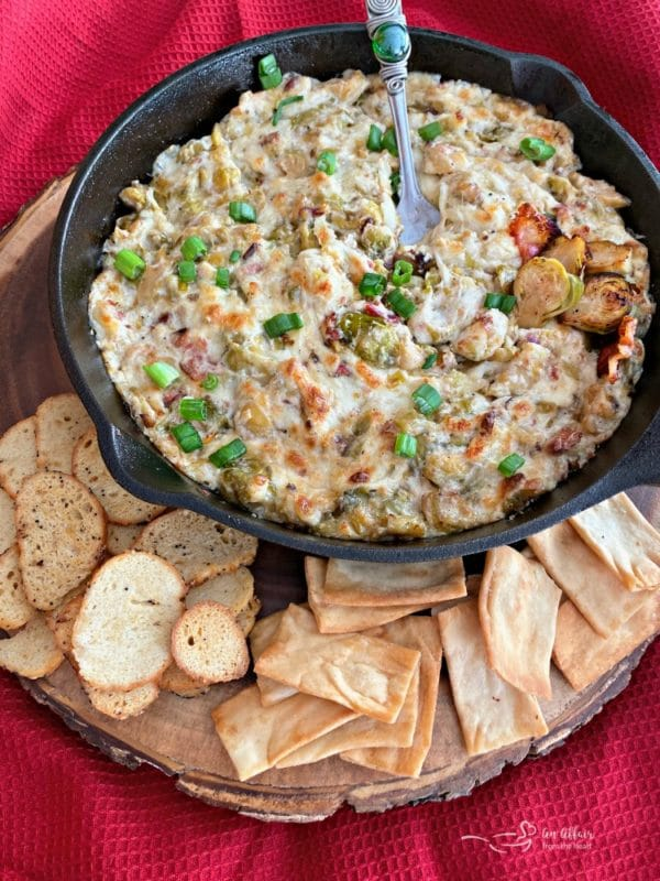 Cheesy Brussels Sprouts Dip with pita and bagel chips