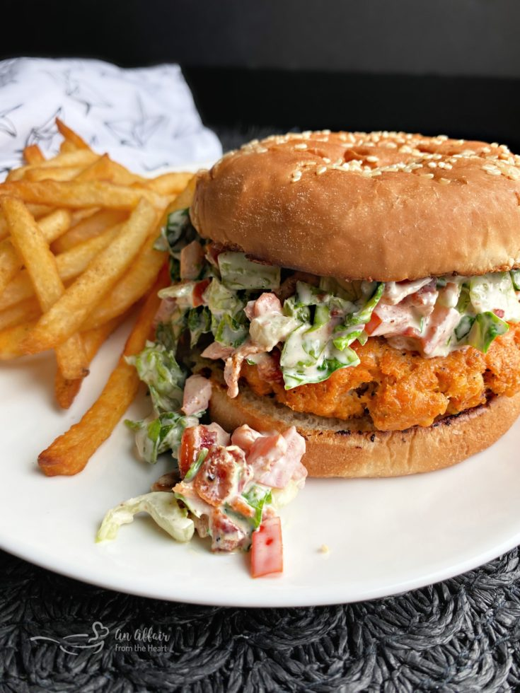 Blackened Salmon Burgers with BLT Slaw with fries on white plate
