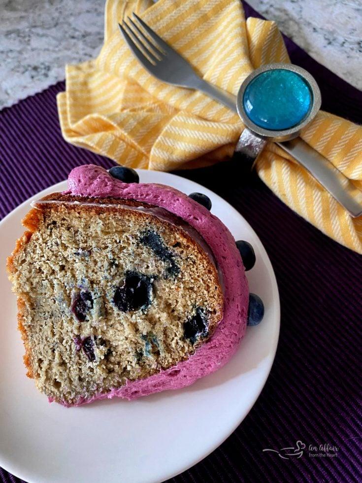 overhead of Blueberry Banana Bundt Cake slice on a white plate