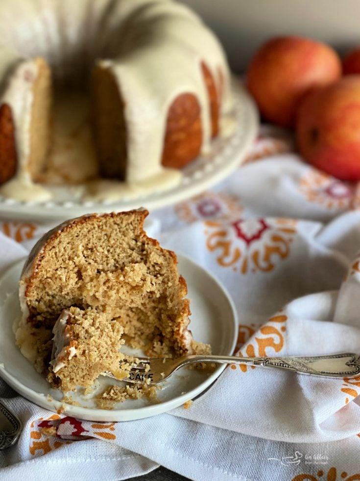 Caramel Apple Tea Cake sliced with a bite on fork