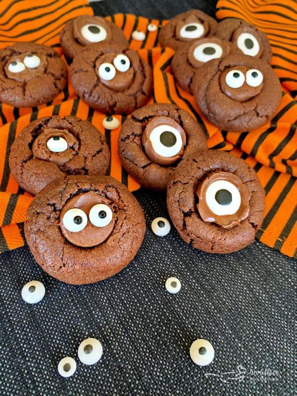 Preparing Halloween Chocolate Sugar cookies - 3 ingredients Halloween cookies on orange and black towel with eyes