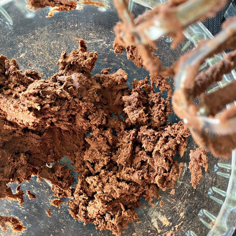 Preparing Halloween Chocolate Sugar cookies mixed up dough in bowl