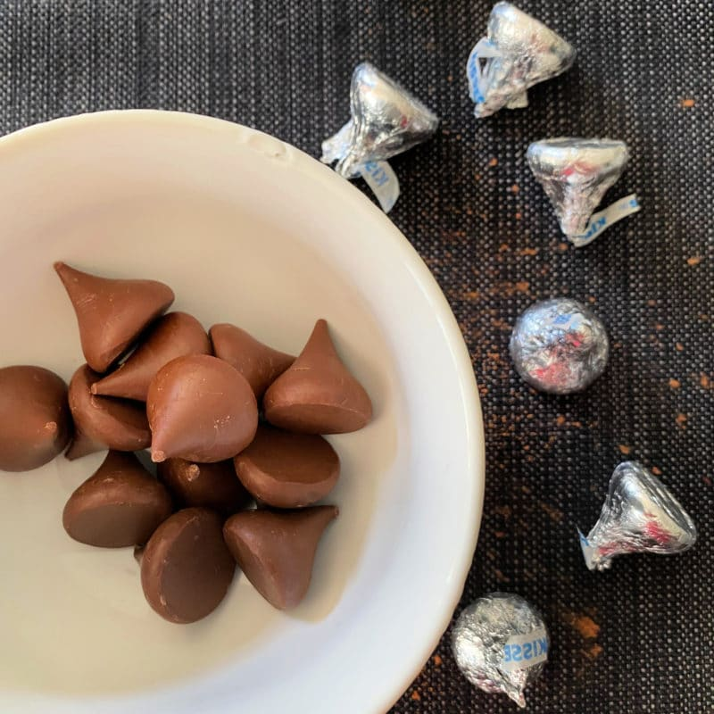 Preparing Halloween Chocolate Sugar cookies with chocolate kisses