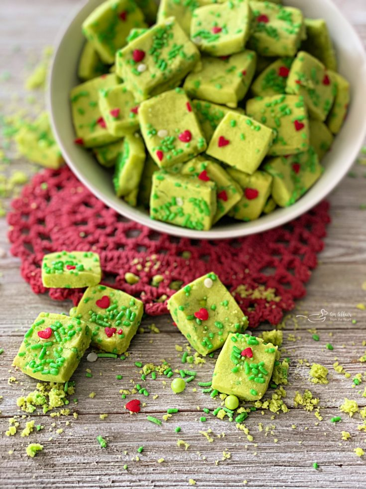 Grinch Shortbread Bites on a red heart shaped doily