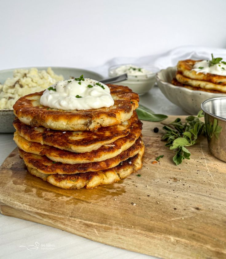 Mashed Potato Cakes stacked on cutting board