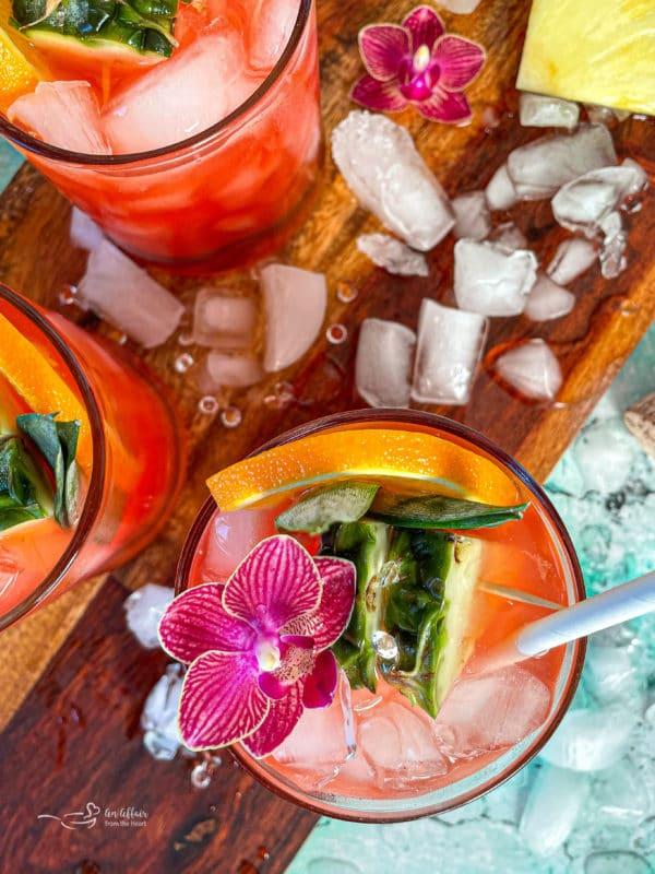Tropical Sparkling Cocktails on wooden background